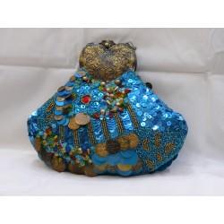 Bolso Joya Turquesa, genial para combinar con loock sobrio, le da un toque de color al conjunto